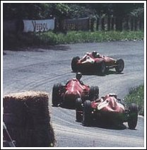 Fangio passes Collins at the Nordkurve